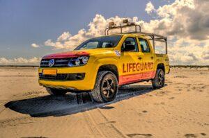 beach holiday clouds lifeguard