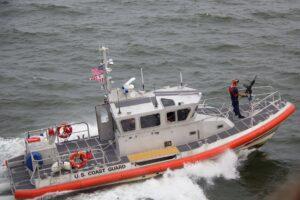 white orange u s coast guard boat on the sea